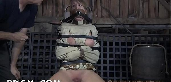 Clamped honey gets her fuck holes pounded with toys