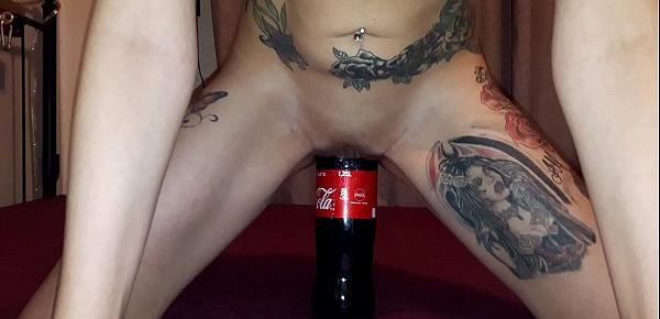 Slut  Lucy rides a huge coke bottle