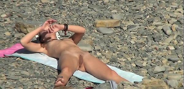 Spy naked girls at the beach shore
