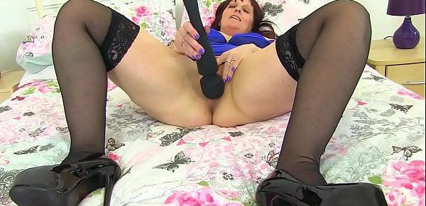 British milf Beau Diamonds massages her clit with sex toy