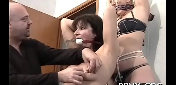 Girls get bounded jointly and titillated by a sex toy