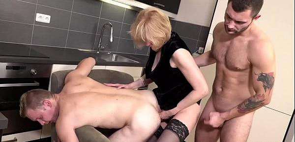 Stockinged GILF pegging hunks ass after sucking two dicks