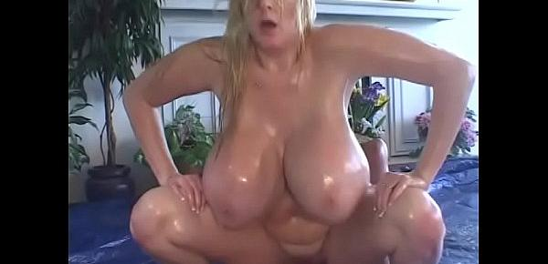 Long haired blond with gigantic knockers oiled up then fucked by stud