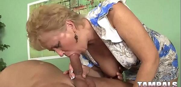 Horny MILF with big tits gives deepthroat blowjob