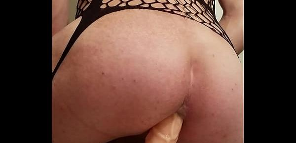 Sissy crossdresser playing with 10 inch dildo