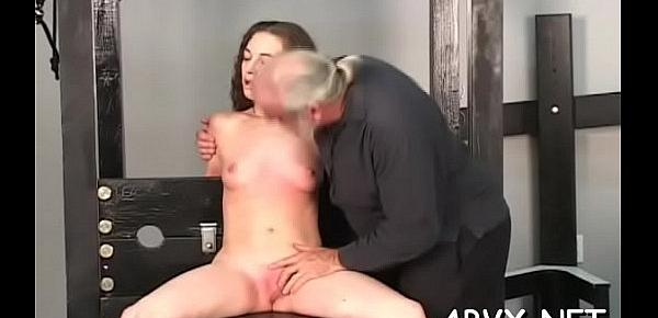 Nude woman stands and endures coarse servitude amateur